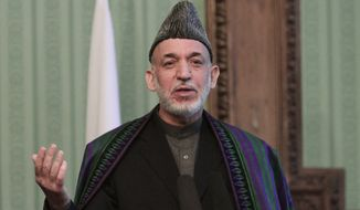 ** In this Nov. 30, 2013, file photo, Afghan President Hamid Karzai speaks during a joint press conference with Pakistani Prime Minister Nawaz Sharif in Kabul, Afghanistan. (AP Photo/Rahmat Gul)