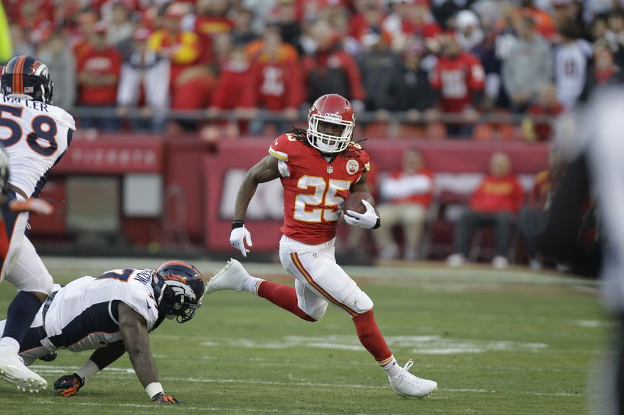 Kansas City Chiefs running back Jamaal Charles (25) runs the ball against the Denver Broncos defense during the first half of an NFL football game, Sunday, Dec. 1, 2013, in Kansas City, Mo. (AP Photo/Ed Zurga)