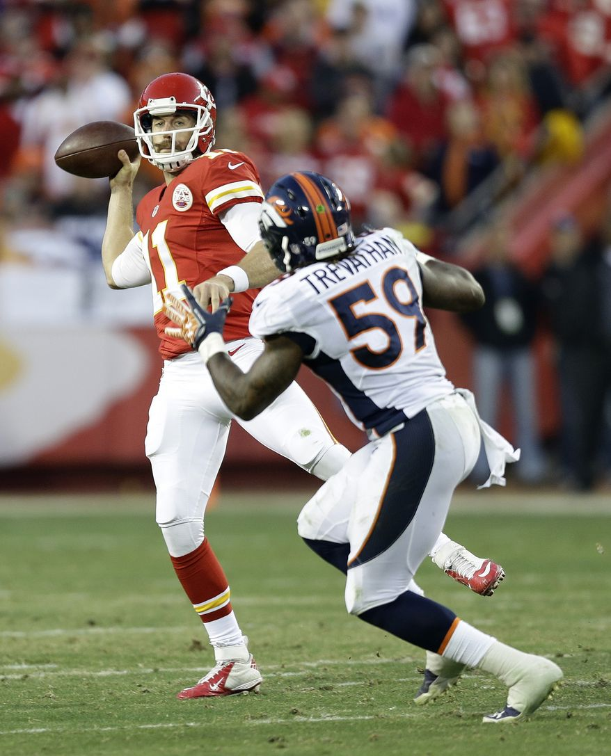 Kansas City Chiefs quarterback Alex Smith (11) throws a pass against Denver Broncos outside linebacker Danny Trevathan (59) during the first half of an NFL football game, Sunday, Dec. 1, 2013, in Kansas City, Mo. (AP Photo/Charlie Riedel)