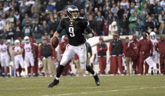 Philadelphia Eagles' Nick Foles in action during the second half of an NFL football game against the Arizona Cardinals, Sunday, Dec. 1, 2013, in Philadelphia. Philadelphia won 24-21. (AP Photo/Michael Perez)