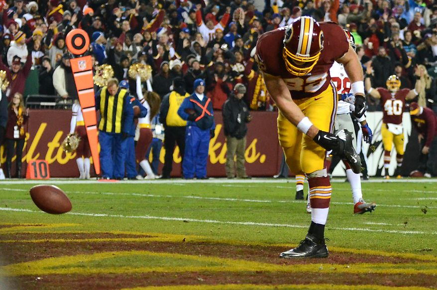 Washington Redskins tight end Logan Paulsen (82) celebrates after scoring  a touchdown as the Washington Redskins play the New York Giants at FedExField, Landover, Md., December 1, 2013. (Dan DeCook/Special to The Washington Times)