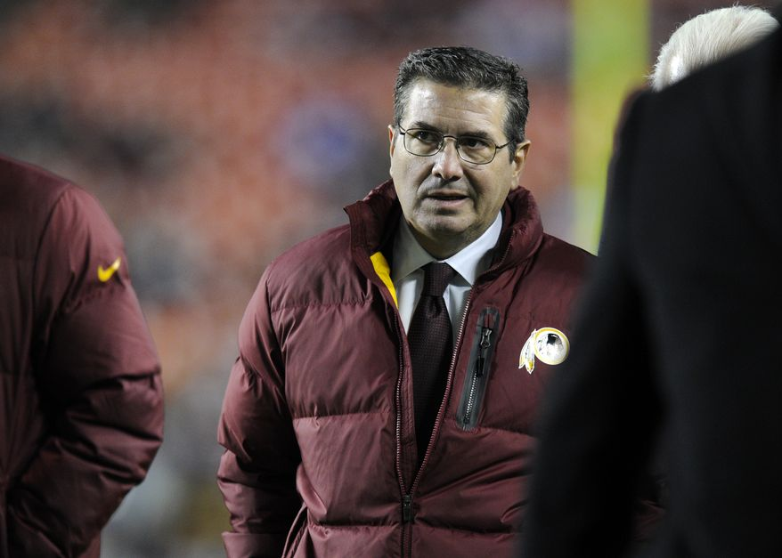 Washington Redskins owner Dan Snyder walks off the field before an NFL football game against the New York Giants Sunday, Dec. 1, 2013, in Landover, Md. (AP Photo/Nick Wass)