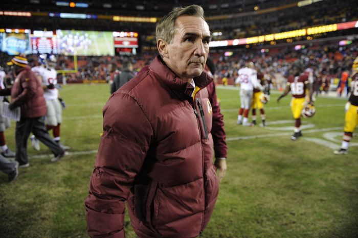 Washington Redskins head coach Mike Shanahan walks off the field after an NFL football game against the New York Giants Sunday, Dec. 1, 2013, in Landover, Md. The Giants won 24-17. (AP Photo/Nick Wass)
