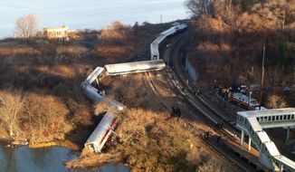 Cars from a Metro-North commuter train are scattered after the train derailed near the Spuyten Duyvil station in the Bronx borough of New York on Sunday, Dec. 1, 2013. (AP Photo/Edwin Valero)