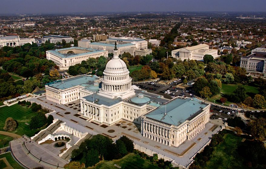 The Capitol in Washington, D.C. is shown in an aerial view Wednesday afternoon, Oct. 24, 2001. The view shows the west side of the Capitol, with the Senate to the left of the dome and the House of Representatives at the right. The three Senate office buildings, Russell, Dirksen, and Hart, left to right, are seen in a cluster beyond the top of the dome. (AP Photo/J. Scott Applewhite)