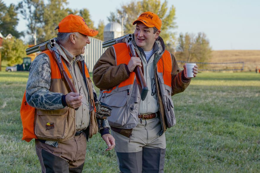 GUNNING FOR A RUN: Rep. Steve King of Iowa takes Sen. Ted Cruz of Texas (right), a prospective Republican presidential candidate, on a pheasant hunt in Mr. King's home state, which will decide early winners and losers. (Associated Press photographs)