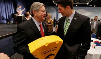 Party for party: Rep. Paul Ryan (right) of Wisconsin presents a cheesehead hat to Terry E. Branstad at the Iowa governor's 67th birthday bash.