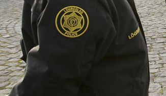 **FILE** Icelandic police officers attend a demonstration outside the Central Bank of Iceland on Oct. 10, 2008. (Associated Press)