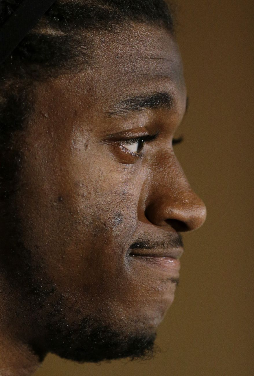Washington Redskins quarterback Robert Griffin III speaks during a media availability after an NFL football game against the New York Giants, Sunday, Dec. 1, 2013, in Landover, Md. The Giants won 24-17. (AP Photo/Patrick Semansky)