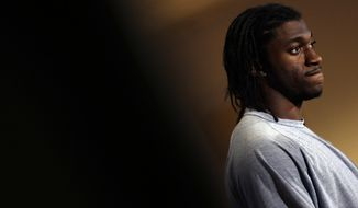 Washington Redskins quarterback Robert Griffin III pauses while speaking during a media availability after an NFL football game against the New York Giants Sunday, Dec. 1, 2013, in Landover, Md. The Giants won 24-17. (AP Photo/Patrick Semansky)