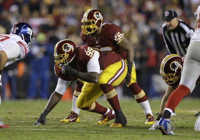 Washington Redskins defensive end Jarvis Jenkins (99) and inside linebacker Perry Riley (56) line up for a play during the first half of an NFL football game against the New York Giants, Sunday, Dec. 1, 2013, in Landover, Md. (AP Photo/Patrick Semansky)