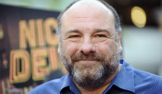 "** FILE ** This May 20, 2013, file photo shows actor James Gandolfini at the LA premiere of ""Nicky Deuce"" in Los Angeles. Cast members of ""The Sopranos"" were on hand Sunday, Dec. 1, 2013, as the northern New Jersey town of Park Ridge dedicated a section of its Park Avenue to Gandolfini, who died in Italy in June at age 51. (Photo by Richard Shotwell/Invision/AP, file)"