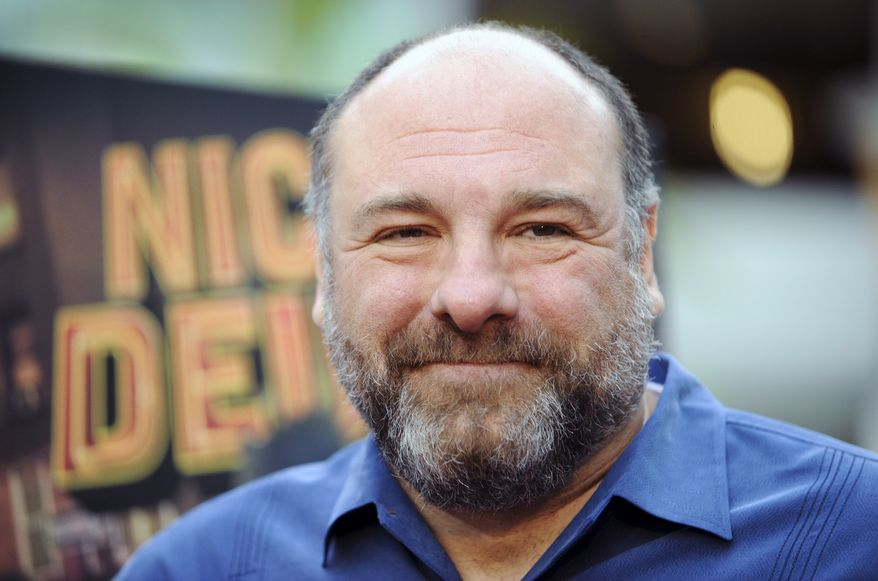 """** FILE ** This May 20, 2013, file photo shows actor James Gandolfini at the LA premiere of """"Nicky Deuce"""" in Los Angeles. Cast members of """"The Sopranos"""" were on hand Sunday, Dec. 1, 2013, as the northern New Jersey town of Park Ridge dedicated a section of its Park Avenue to Gandolfini, who died in Italy in June at age 51. (Photo by Richard Shotwell/Invision/AP, file)"""