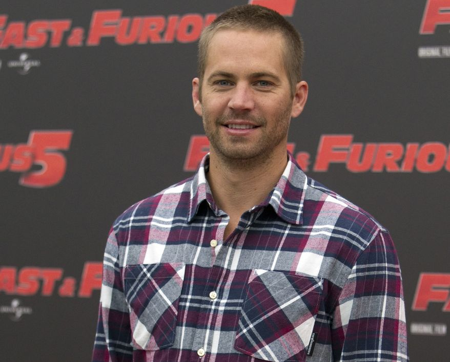 """Actor Paul Walker poses during the photo call for the movie """"Fast and Furious 5"""" in Rome on April 29, 2011. (AP Photo/Andrew Medichini)"""