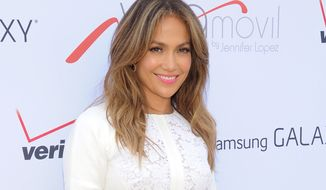 "** FILE ** This July 26, 2013, file photo shows singer and actress Jennifer Lopez at the ""Viva Movil by Jennifer Lopez"" flagship store grand opening in the Brooklyn borough of New York. Lopez, the 44-year-old mother of 5-year-old twins, Maximilian and Emme, will receive the Grace Kelly Award at the March of Dimes luncheon at the Beverly Hills Hotel on Friday, Dec. 6, 2013. (Photo by Evan Agostini/Invision/AP, File)"