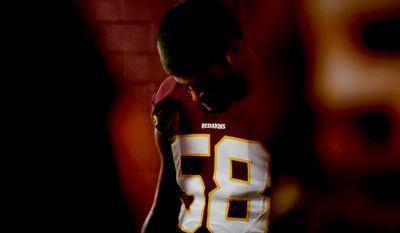Washington Redskins linebacker Josh Hull (58) bows his head in prayer inside the tunnel before the Washington Redskins play the New York Giants in Sunday Night Football at FedExField, Landover, Md., Sunday, December 1, 2013. (Andrew Harnik/The Washington Times)