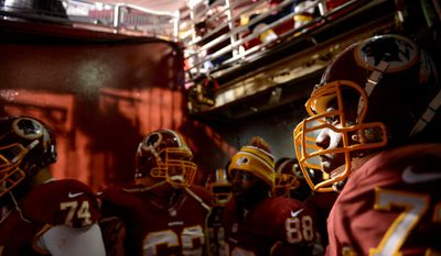 Washington Redskins guard Adam Gettis (73), right, and teammates wait to take the field before the Washington Redskins play the New York Giants in Sunday Night Football at FedExField, Landover, Md., Sunday, December 1, 2013. (Andrew Harnik/The Washington Times)