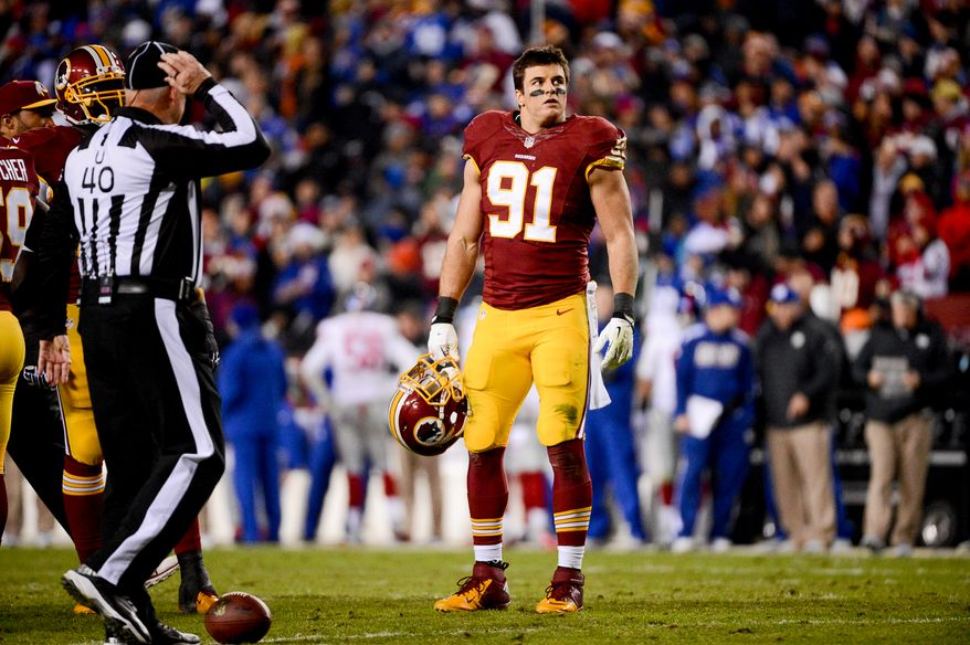 Washington Redskins outside linebacker Ryan Kerrigan (91) takes his helmet off during a break in action as the Washington Redskins play the New York Giants in Sunday Night Football at FedExField, Landover, Md., Sunday, December 1, 2013. (Andrew Harnik/The Washington Times)