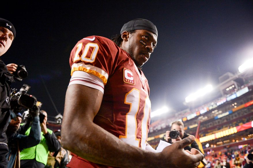 Washington Redskins quarterback Robert Griffin III (10) heads to the locker room after the Washington Redskins lose to the New York Giants 24-17 in Sunday Night Football at FedExField, Landover, Md., Monday, December 2, 2013. (Andrew Harnik/The Washington Times)