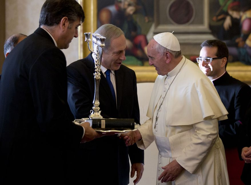 Israeli Prime Minister Benjamin Netanyahu, left, presents Pope Francis with a Menorah during their meeting at the Vatican, Monday, Dec. 2, 2013. Netanyahu is on a visit to Italy, which include a meeting with Pope Francis at the Vatican. (AP Photo/Alessandra Tarantino, Pool)