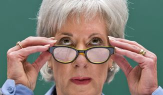 ** FILE ** Health and Human Services Secretary Kathleen Sebelius testifies on Capitol Hill in Washington, Wednesday, Oct. 30, 2013, before the House Energy and Commerce Committee hearing on the difficulties plaguing the implementation of the Affordable Care Act. (AP Photo/J. Scott Applewhite, File)