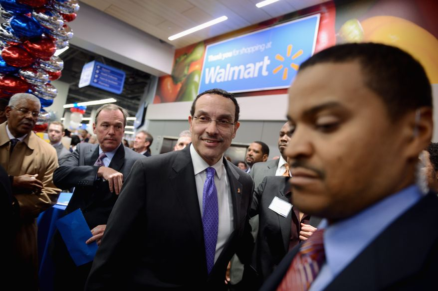 Talking shop: D.C. Mayor Vincent C. Gray, who touts his economic record, visits one of the first Wal-Marts in the city on the eve of its opening. Story, A11. (Andrew Harnik/The Washington Times)