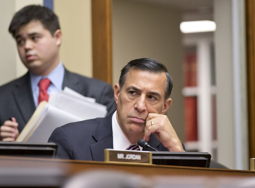 House Oversight Committee Chairman Rep. Darrell Issa, R-Calif., listens to criticism from a Democratic member of the panel during a hearing on the problems with implementation of the Obamacare healthcare program, and specifically, the HealthCare.gov website, on Capitol Hill in Washington, Wednesday, Nov. 13, 2013. (AP Photo/J. Scott Applewhite)