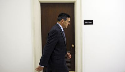 House Oversight and Government Reform Committee Chairman Rep. Darrell Issa, R-Calif. returns to the committee's offices on Capitol Hill in Washington, Tuesday, June 4, 2013, after a break in a closed-door session of the committee where former Ambassador Thomas Pickering was giving a deposition regarding events in Benghazi, Libya. (AP Photo/Cliff Owen)