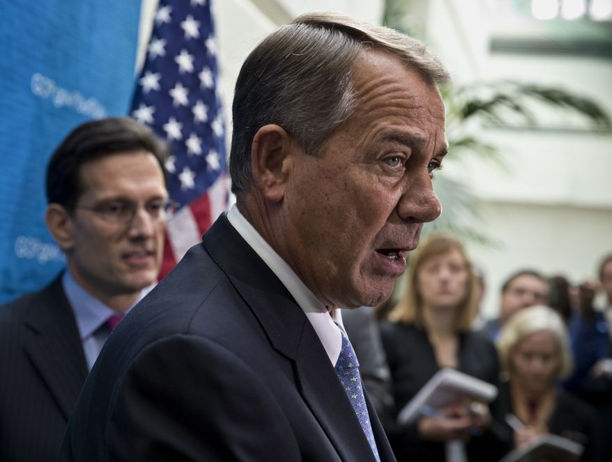 House Speaker John Boehner of Ohio, right, joined by House Majority Leader Eric Cantor of Va., and other House GOP leaders, meets with reporters following a closed-door strategy session, on Capitol Hill in Washington, Tuesday, Dec. 3, 2013.  (AP Photo/J. Scott Applewhite)