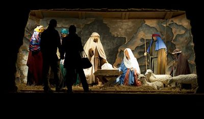 """** FILE ** Visitors are silhouetted as they view the Nativity scene during the 34th annual """"Festival of Lights"""" at the Church of Jesus Christ of Latter-day Saints' Washington Temple in Kensington, Md., on Wednesday, Dec. 14, 2011. (The Washington Times)"""
