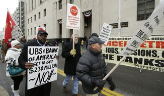 The Rev. Charles Williams II, left, leads Detroit city workers in a protest outside the federal courthouse in Detroit while awaiting the bankruptcy decision, Tuesday, Dec. 3, 2013. (AP Photo/Carlos Osorio)