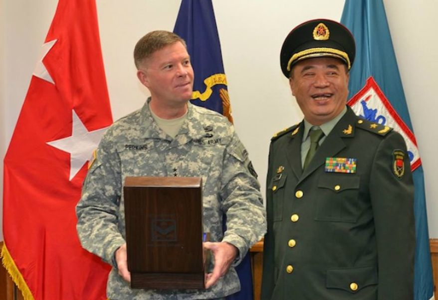 CAC Commanding General, Lt. Gen. David G. Perkins, exchanges a gift with Maj. Gen. Chen Dongdeng, the Director of Military Management of the Department of General Staff from the People's Liberation Army of the People's Republic of China. (Image: U.S. Army)