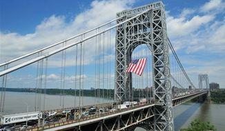 ** FILE ** Commuters pass over the George Washington Bridge. (Associated Press)