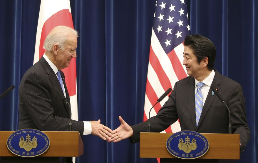 "U.S. Vice President Joe Biden shakes hands with Japanese Prime Minister Shinzo Abe at the end of a joint press conference following their meeting at Abe's official residence in Tokyo Tuesday, Dec. 3, 2013. Biden voiced strong opposition Tuesday to China's new air defense zone above a set of disputed islands, showing a united front with an anxious Japan as tension in the region simmered. Standing side by side in Tokyo with Abe, Biden said the U.S. is ""deeply concerned"" about China's attempt to unilaterally change the status quo in the East China Sea. (AP Photo/Koji Sasahara)"