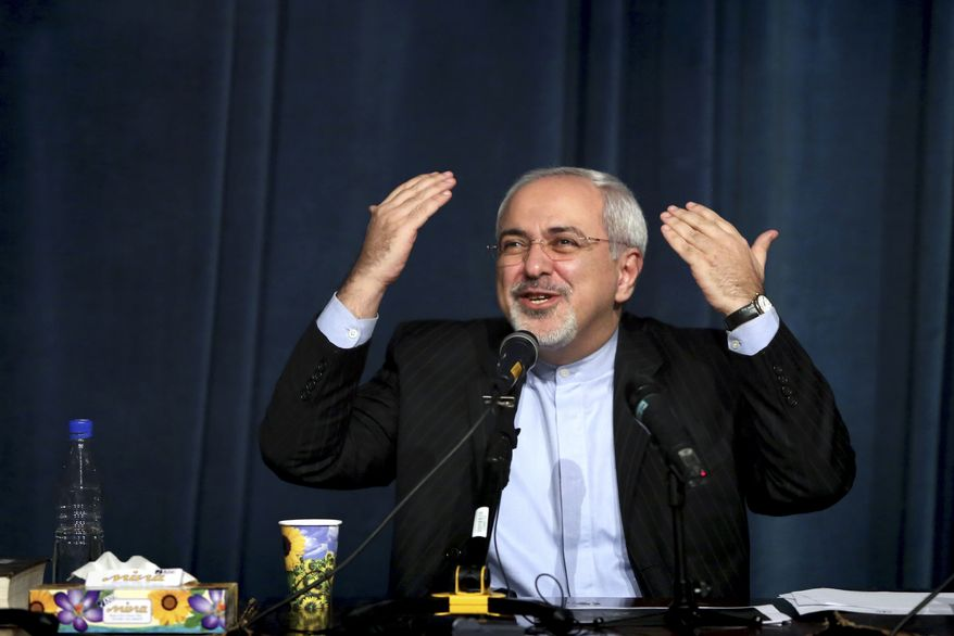 Iran's foreign minister Mohammad Javad Zarif, delivers an address to students at the University of Tehran in Tehran, Iran, Tuesday, Dec. 3, 2013. Iran's foreign minister is saying Israeli Prime Minister Benjamin Netanyahu has become desperate after last month Iran agreed to cap its nuclear program in return to easing sanctions by the West. (AP Photo/Ebrahim Noroozi)