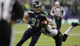 Seattle Seahawks wide receiver Golden Tate runs after catching a pass in front of New Orleans Saints cornerback Corey White in the first half of an NFL football game, Monday, Dec. 2, 2013, in Seattle. (AP Photo/Scott Eklund)