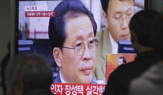 People at the Seoul Railway Station in South Korea watch a TV news program showing North Korean leader Kim Jong-un's uncle, Jang Song-thaek, on Tuesday, Dec. 3, 2013. Two South Korean lawmakers say they were told by intelligence officials that two associates of Mr. Jang were executed last month and that the uncle has not been seen publicly since then, indicating he may have been dismissed. (AP Photo/Ahn Young-joon)