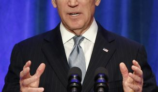 **FILE** Vice President Joseph R. Biden delivers a speech during a business leaders breakfast at the St. Regis Beijing hotel in Beijing on Dec. 5, 2013. (Associated Press