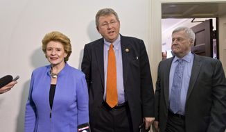 **FILE** Senate Agriculture Committee Chair Sen. Debbie Stabenow, D-Mich., left, and House Agriculture Committee Chairman Rep. Frank Lucas, R-Okla., right, are intercepted by reporters after negotigations on the Farm Bill wrapped up on Capitol Hill in Washington, Wednesday, Dec. 4, 2013. At far right is the House Agriculture Committee Ranking Democrat Rep. Collin Peterson, D-Minn. There is agreement on many parts of the legislation but significant differences remain over funding for the Supplemental Nutrition Assistance Program, more commonly known as food stamps. (Associated Press)