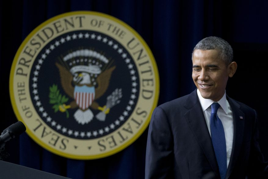 President Barack Obama turns to the podium as he arrives to speak about the new health care law during a White House Youth Summit, Wednesday, Dec. 4, 2013, in the South Court Auditorium in the Eisenhower Executive Office Building on the White House complex in Washington. (AP Photo/Carolyn Kaster)