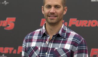 "** FILE ** In this April 29, 2011, file photo, actor Paul Walker poses during the photo call of the movie ""Fast and Furious 5,"" in Rome. (AP Photo/Andrew Medichini, File)"