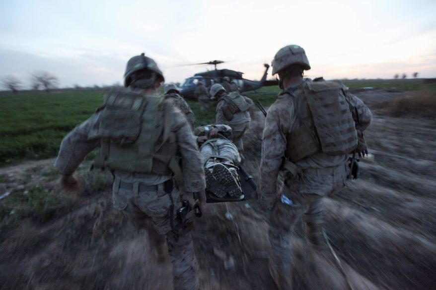 During a medevac mission by the U.S. Army's Task Force Pegasus, Marines carry a wounded comrade to a waiting helicopter. In 2011, as U.S. troops peaked at 100,000, 419 Americans were killed. In 2012, as the troop count began to decrease, the death toll fell to 319, three times what it was in 2006-2007. (Associated Press photographs)