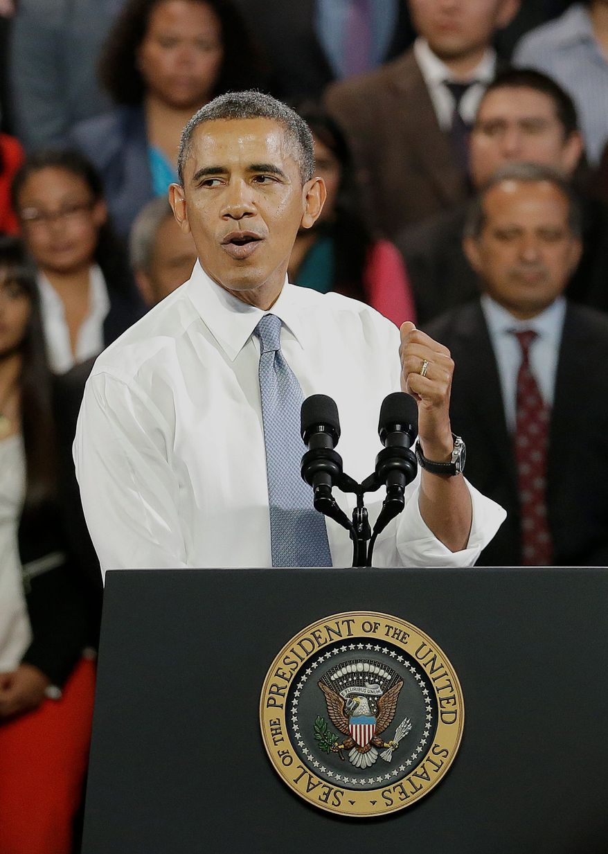President Obama has been trying to reach an agreement about immigration reform with Congress, but activists he addresses are pressuring him to simply use executive authority to halt all deportations. (Associated Press)