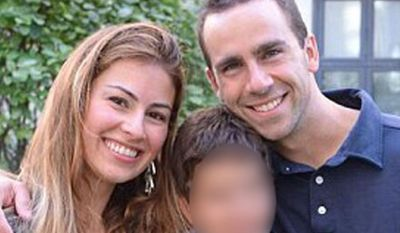 Teacher Ronald Smith with his wife and young son, was shot dead while out for a morning jog in Benghazi. Twitter
