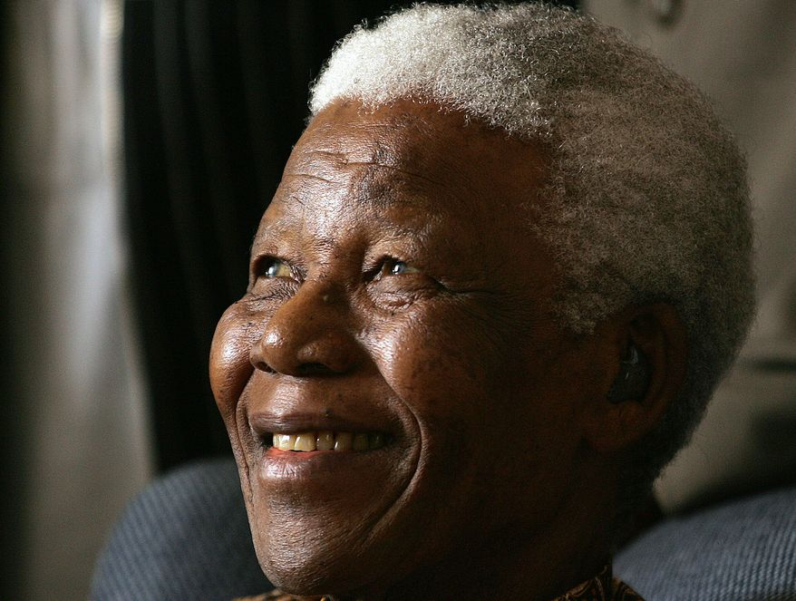 Former South African President Nelson Mandela smiles during his meeting with a group of Mandela Rhodes Scholars for 2006, in Johannesburg, South Africa, Tuesday, Jan. 31, 2006. Mandela, fresh from a two-week holiday in Mauritius,  was in high spirits when he met the 15 students chosen to benefit from a scholarship of which he is the patron. (AP Photo/Themba Hadebe)