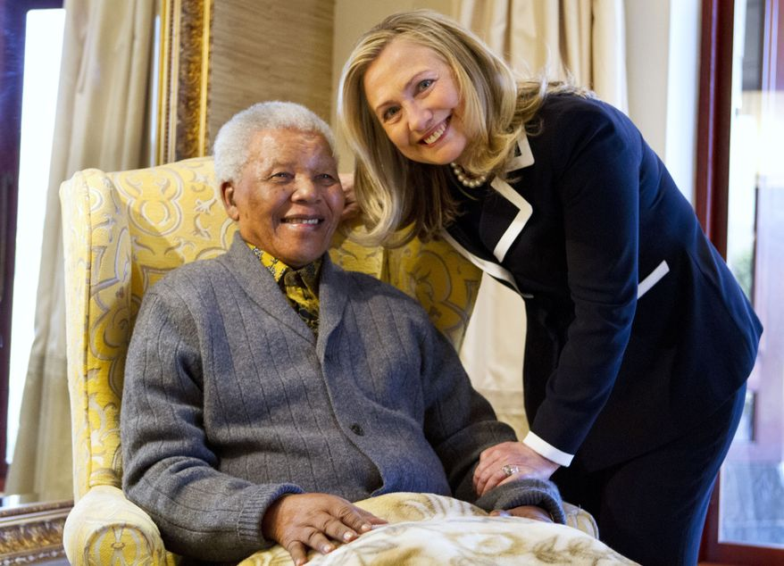 Secretary of State Hillary Rodham Clinton meets with former South Africa President Nelson Mandela, 94, at his home in Qunu, South Africa, Monday, Aug. 6, 2012. (AP Photo/Jacquelyn Martin, Pool)
