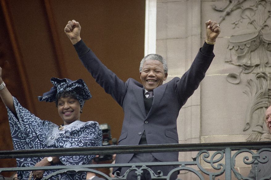 Deputy leader of the African National Congress Nelson Mandela and his wife Winnie waving from a Strasbourg's Town Hall balcony Wednesday, June 13, 1990. Mandela is here to address the European Parliament regarding economical sanctions against South Africa. (AP Photo/Christian Lutz)