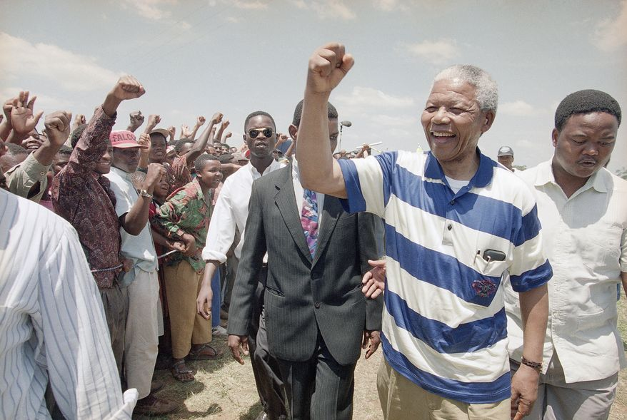 """President of the African National Congress Nelson Mandela gives the """"black power"""" salute to his supporters after his arrival at a rally in the rural town of Ingwavuma in northern natal Saturday, Nov. 20, 1993. Mandela is campaigning for the April 27, 1993 elections in Natal, one of the most violent regions in South Africa. (AP Photo/David Brauchli)"""