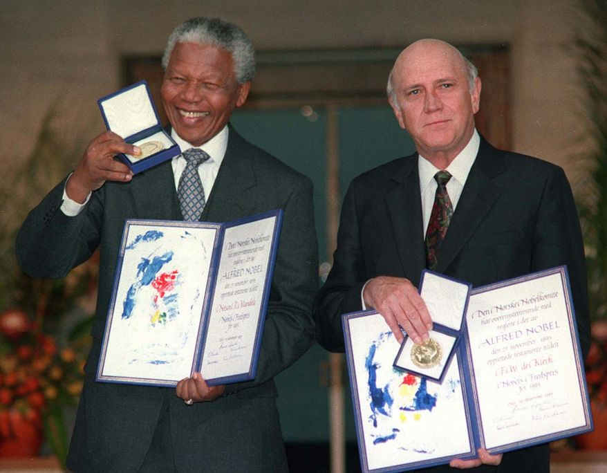 South African Deputy President F.W. de Klerk, right, and South African President Nelson Mandela pose with their Nobel Peace Prize Gold Medal and Diploma, in Oslo, December 10, 1993. De Klerk announced at a press conference in Cape Town, Tuesday Aug. 26, 1997, that he was resigning as head of South Africa's National Party, and would quit politics.(AP Photo/NTB)