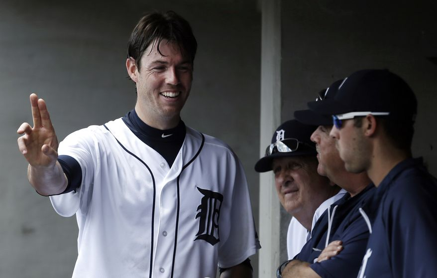 Detroit Tigers' pitcher Doug Fister talks with teammates in the dugout about a pitch against the Los Angeles Angels in the sixth inning of a baseball game in Detroit, Thursday, June 27, 2013. (AP Photo/Paul Sancya)